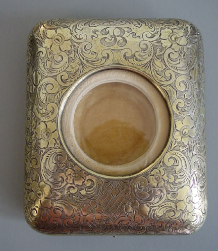 STERLING silver gilt watch holder with chased scroll