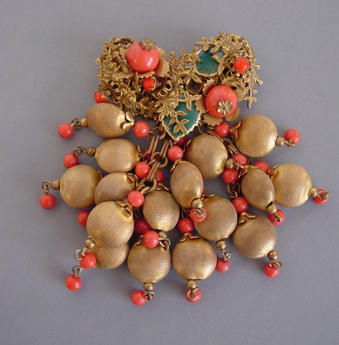 AMOURELLE brooch with orange glass beads, green enameled leaves