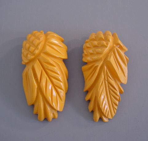 BAKELITE carved pineapple carved sunflower dress clips