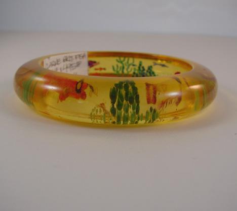 JUDY CLARKE bakelite apple juice sea life reverse carved bangle