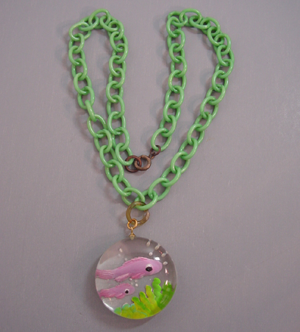 JUDY CLARKE Lucite pendant with lavender reverse carved fish