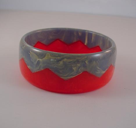 DOMBEK bakelite red and medium blue swirl zigzag bangle