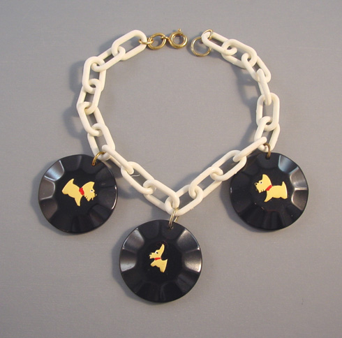 FOLTZ black bakelite charm bracelet with butterscotch dogs