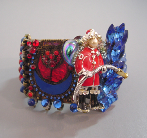 WENDY GELL Wristy, fireman with red and blue glass cabochons