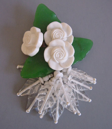 MIRIAM HASKELL Hess dress clip of green glass leaves, white flowers
