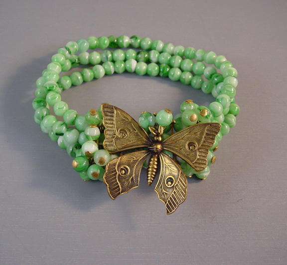 MIRIAM HASKELL Hess green glass bead and gold tone butterfly
