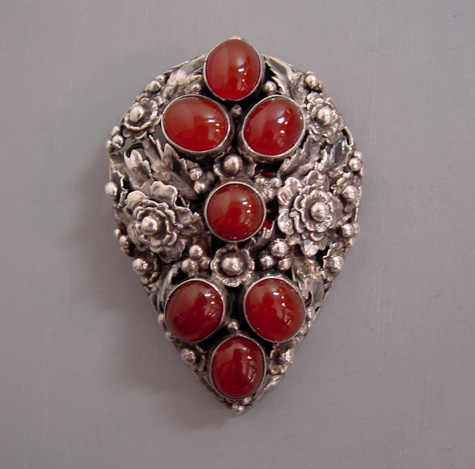 HOBE dress clip in sterling silver with carnelian colored glass