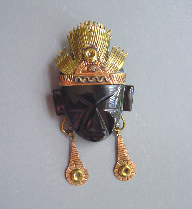 MEXICO onyx or black glass face brooch