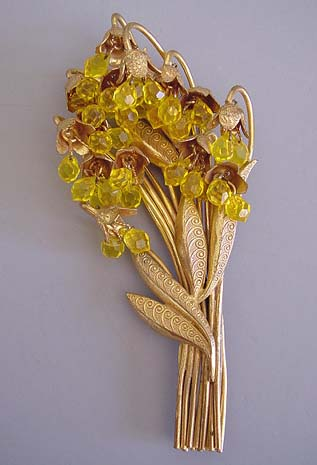 GOLD TONE large bouquet brooch with faceted topaz glass