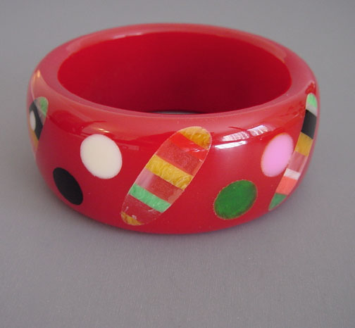 SHULTZ bakelite red bangle with dots and striped dots