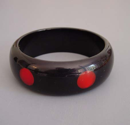 SHULTZ bakelite black bangle with red dots