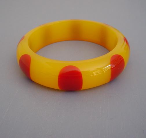 SHULTZ bakelite translucent lemon yellow bangle, red dots