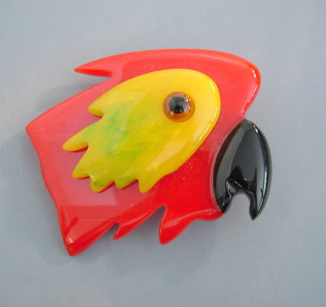 SHULTZ bakelite parrot head brooch in red