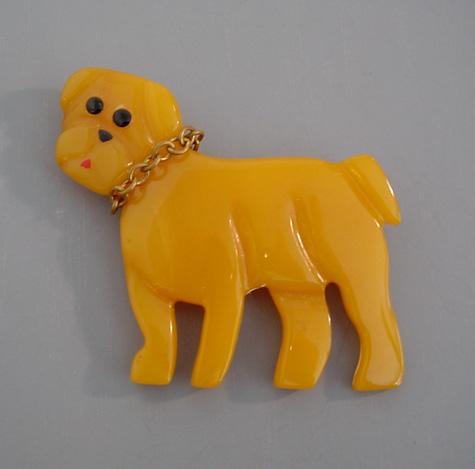SHULTZ bakelite yellow carved dog brooch