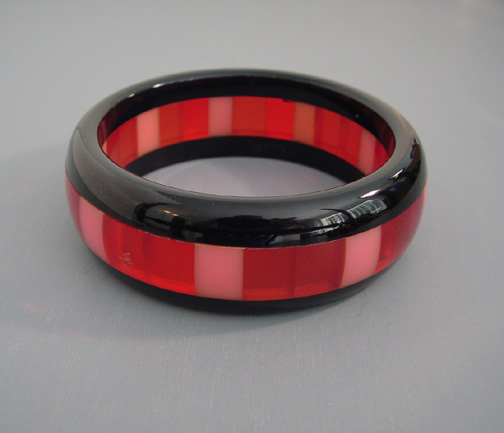 SHULTZ bakelite 3 row laminated bangle with opaque pink & transp