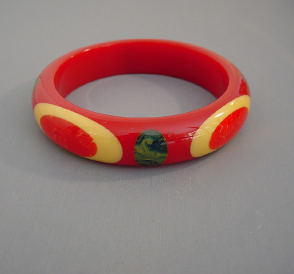 SHULTZ bakelite red bangle with red & cream dots
