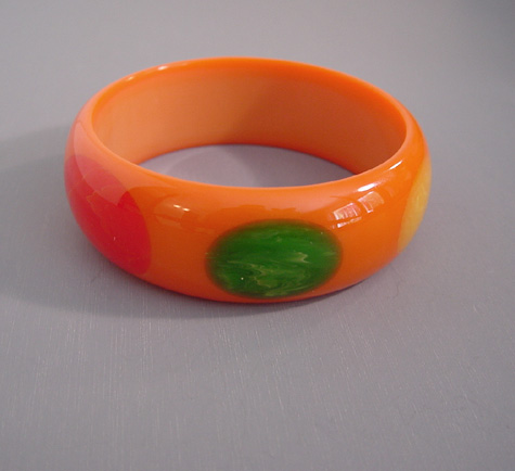 SHULTZ bakelite orange bangle with dots