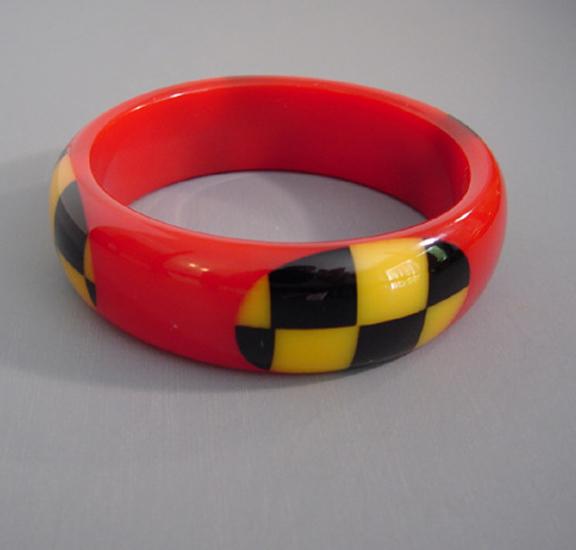 SHULTZ bakelite red bangle, yellow, black check dots