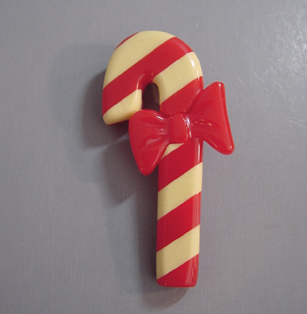 SHULTZ bakelite Christmas red and cream candy cane brooch
