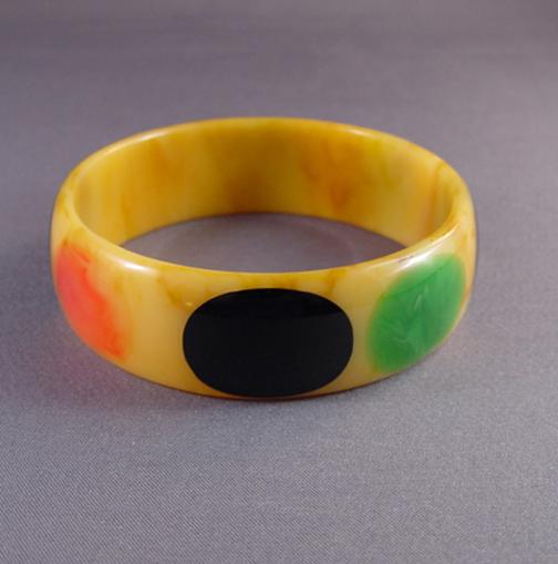 SHULTZ bakelite marbled tan bangle, red, blue pink, green dots