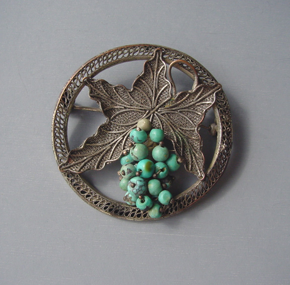 CHINESE grapes brooch with small turquoise nuggets