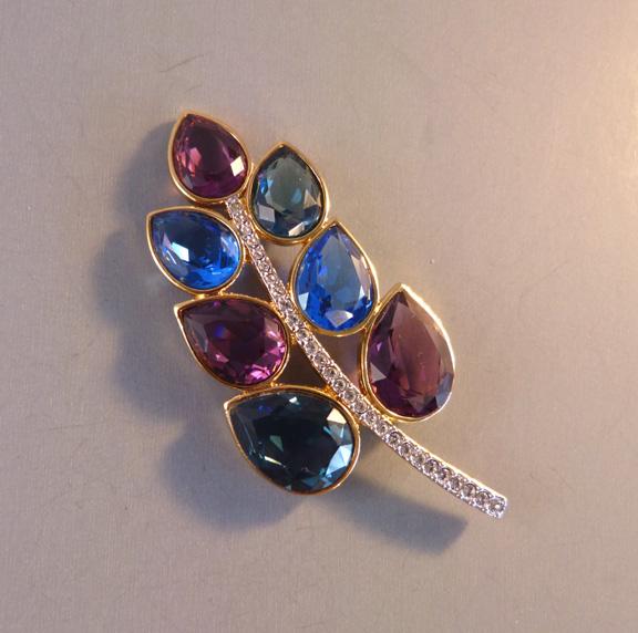 SWAROVSKI stylized leaf brooch with purple, green, blue crystals