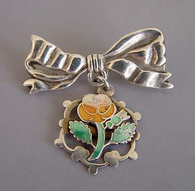 VICTORIAN silver enamel bow brooch, orange flower
