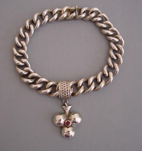 VICTORIAN sterling silver charm bracelet and shamrock charm