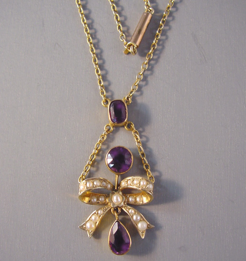 VICTORIAN 9 ct, amethyst, seed pearl bow pendant lavalier
