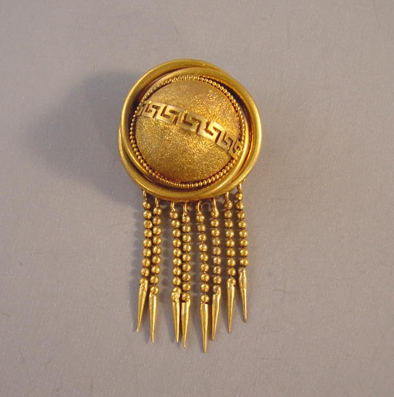 VICTORIAN gold tone metal half dome brooch with foxtails