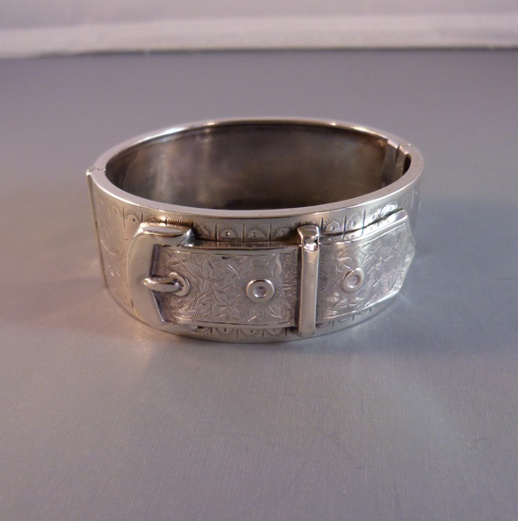 VICTORIAN sterling bangle with buckle motif, 1880s