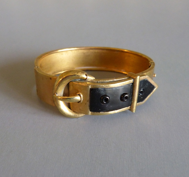 VICTORIAN gold tone hinged buckle bangle with jet inset