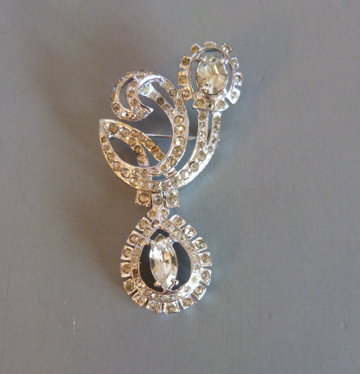 "EISENBERG ""Decoration"" brooch hand set clear rhinestones, 1946"
