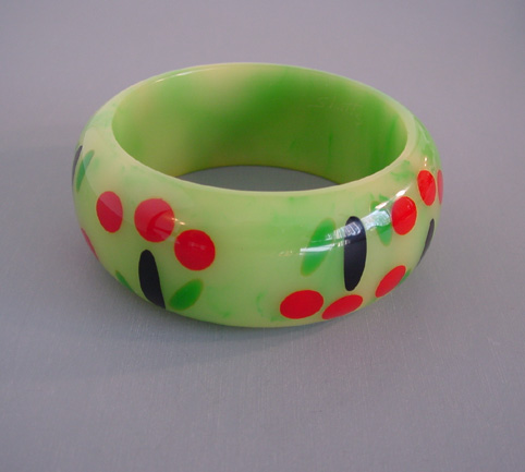 SHULTZ bakelite green swirl bangle with cherry motif in red, black and green