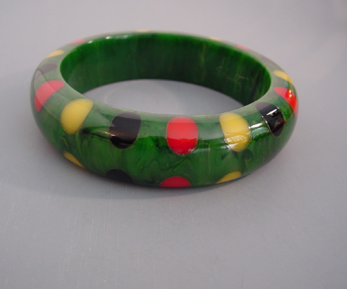 SHULTZ bakelite green marbled bangle with red, yellow and black bow tie dots