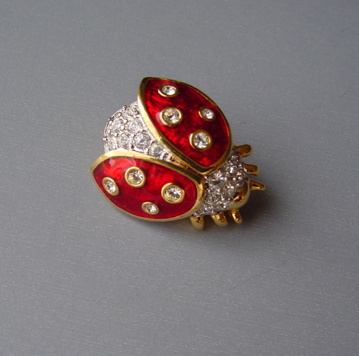 SWAROVSKI ladybug pin with brilliant red enameling
