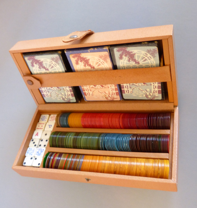 BAKELITE boxed poker chips set with three sets of old playing cards