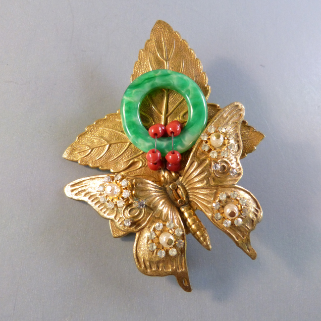 HASKELL by Hess butterfly brooch with green glass circle