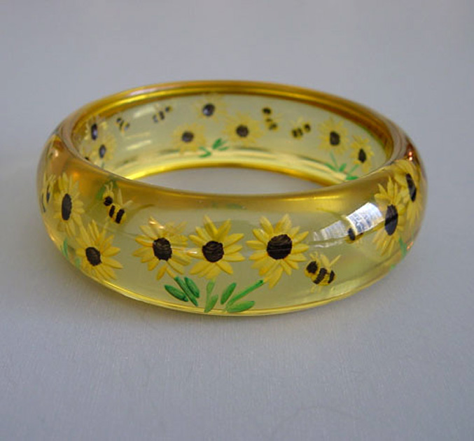 SHULTZ bakelite apple juice bangle, reverse carved sunflowers & bees