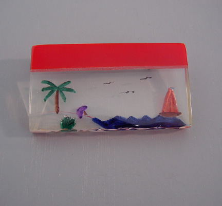 SHULTZ bakelite red & Lucite sea shore brooch with sailboat, fish