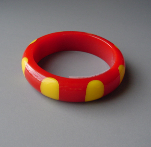 SHULTZ bakelite red bangle with 8 yellow dots, a great mixer
