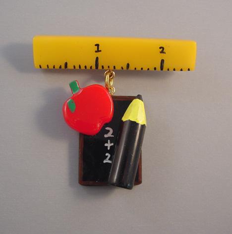 SHULTZ bakelite School Days brooch