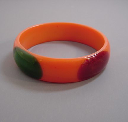 SHULTZ bakelite orange bangle with 4 oval dots