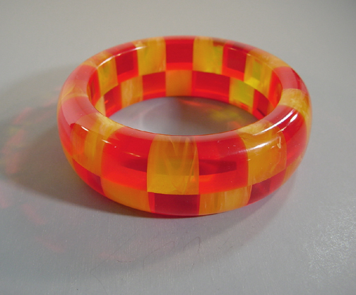 SHULTZ bakelite two row check bangle transparent red & yellow swirl