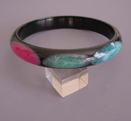 SHULTZ bakelite black spacer bangle with blue, aqua, pink, yellow dots