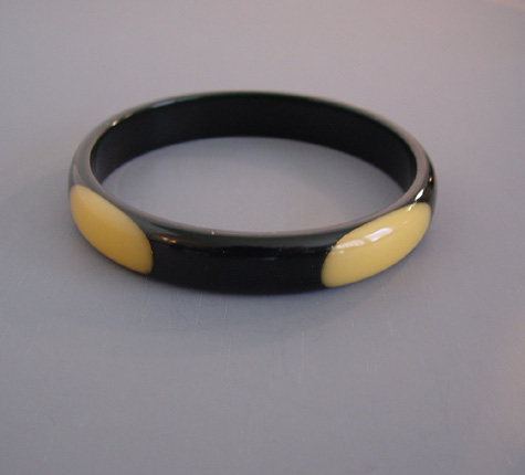 SHULTZ bakelite black spacer bangle with four cream oval dots