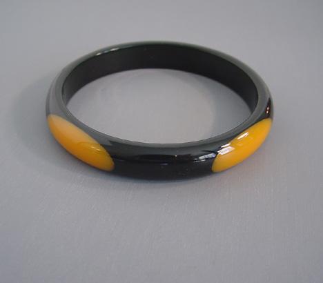 SHULTZ bakelite black spacer bangle with four golden oval dots