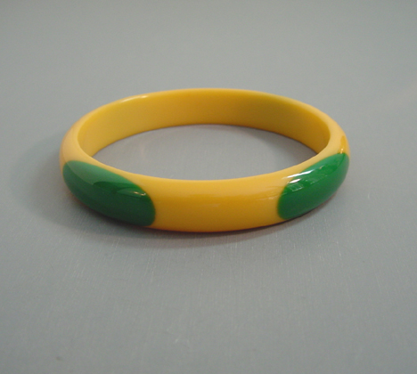 SHULTZ bakelite yellow spacer bangle with green oval dots