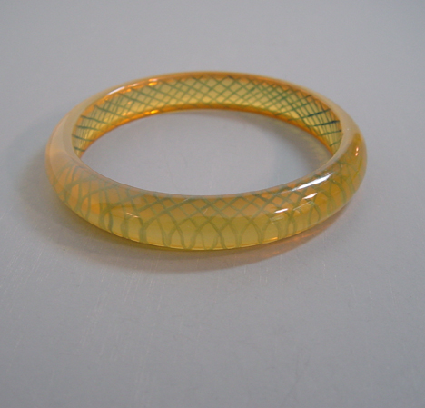 SHULTZ bakelite transparent yellow bangle with green reverse carved
