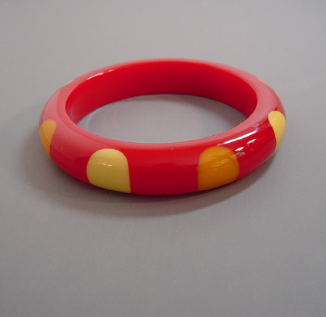 SHULTZ bakelite red bangle with two tones of yellow dots